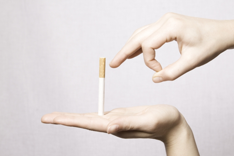 Quitting smoking can help to reduce the yellowing of teeth.