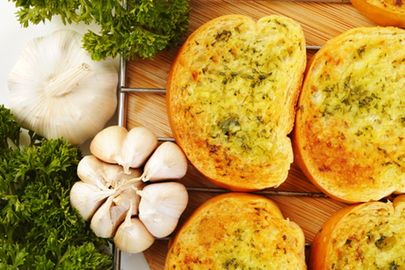 Chowing down on garlic bread could give you bad breath for hours afterward.