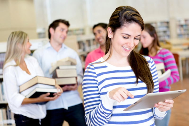 Many students are turning to e-books for better costs and convenience.