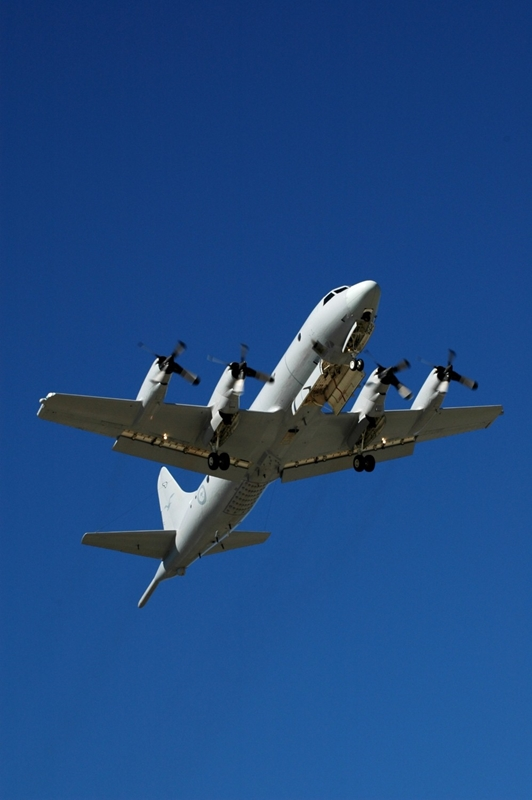 A RAAF AP-3C Orion made a transmission to Chinese vessels during a patrol in the South China Sea.