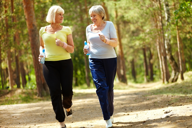 Call it friendly competition if you must, but jogging with a close friend will help you jog better.