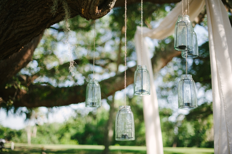 Hang some mason jar garden lights along the trees and from your patio or awning.