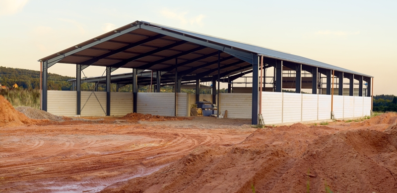 It's easy to herd livestock in in an open barn, but you can also opt for a fully enclosed structure.