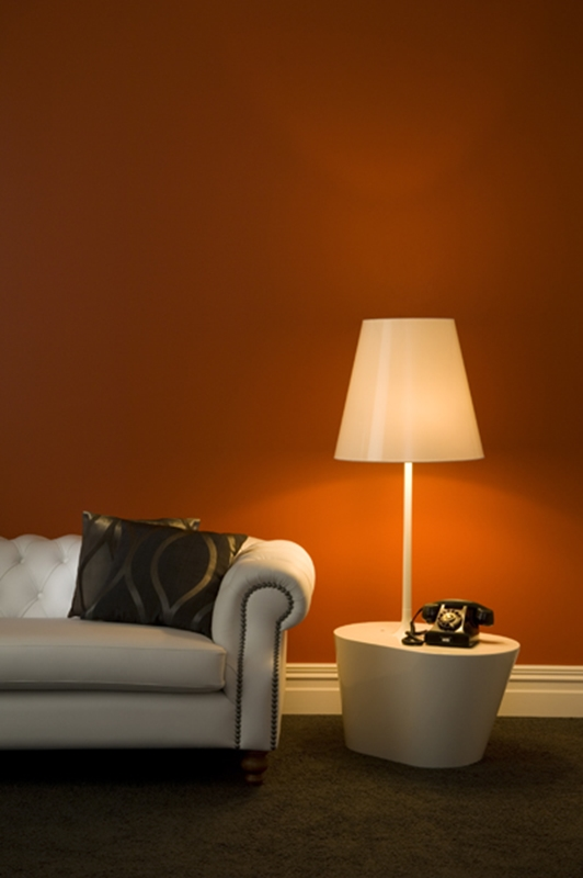 Orange in a living area makes the most of the colour's warmth.