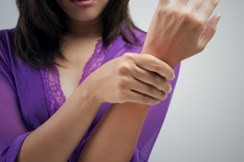 Regular stretching can help employees manage wrist pain.