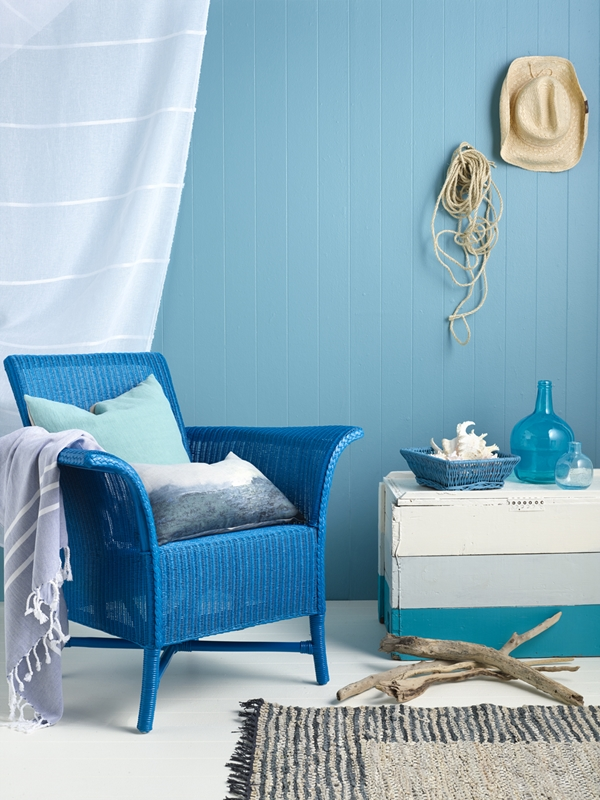 A pale blue background with a few beachy items make this room as summery as it gets.
