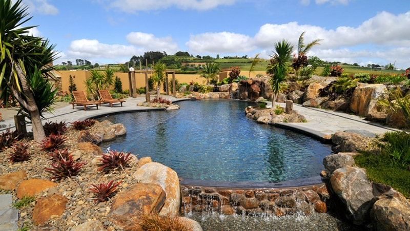 An exotic, rustic-chic waterfall pool by Donaldson Pools.