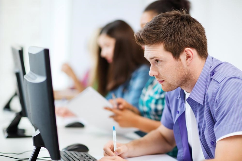 Young professionals are deeply engaged in technology.