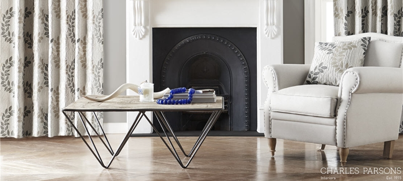 The scrolling leaf motifs of our Christelle solid drapery enhance this modern yet simultaneously vintage fireplace.