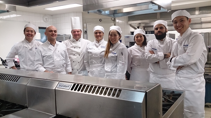 Andrew with students he inspires in Kenvale Kitchen.