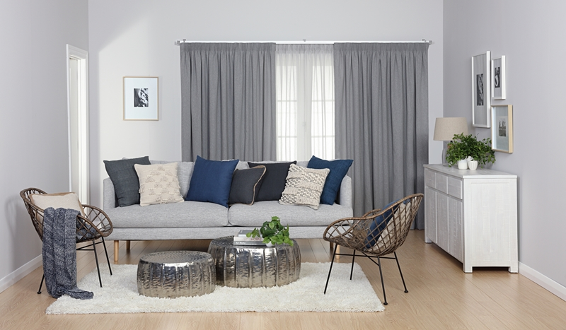 The sheer curtains makes softens the light in the room, giving it the perfect balance of natural light.