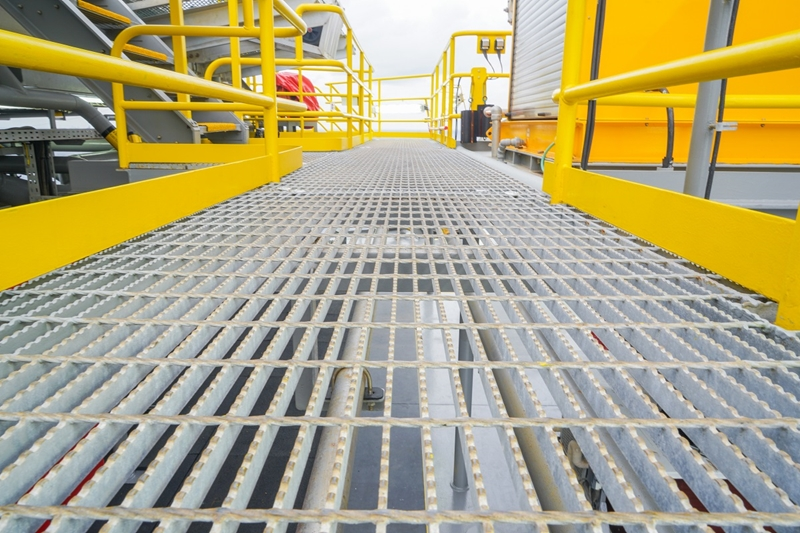 A close up of a metal grating floor.
