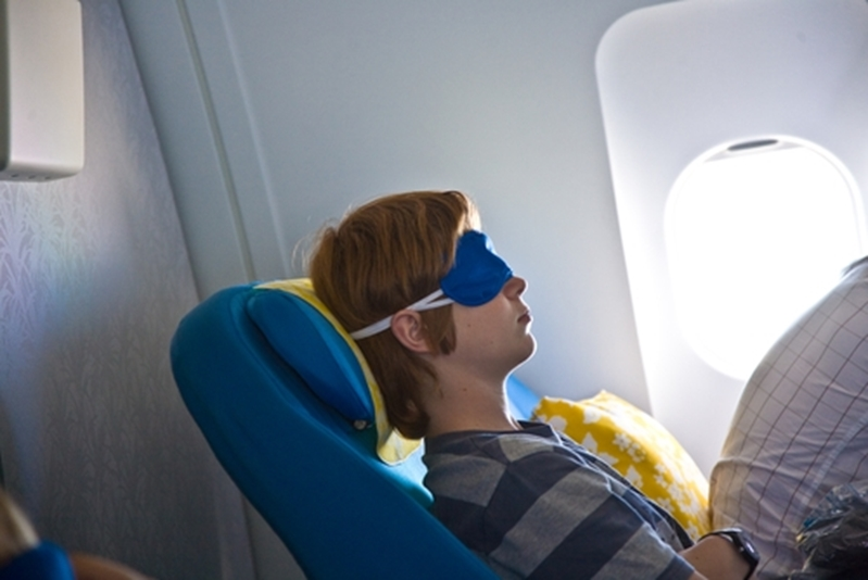 Wearing an eye mask can help you sleep as you fly to exciting destinations.
