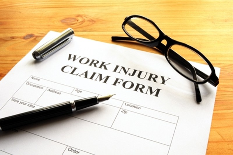 workers comp form, injury, glasses, pen