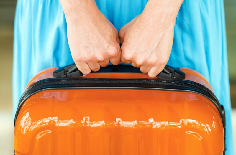While packing your carry-on for a long-haul flight, consider adding some items to help you pass the time and freshen up.