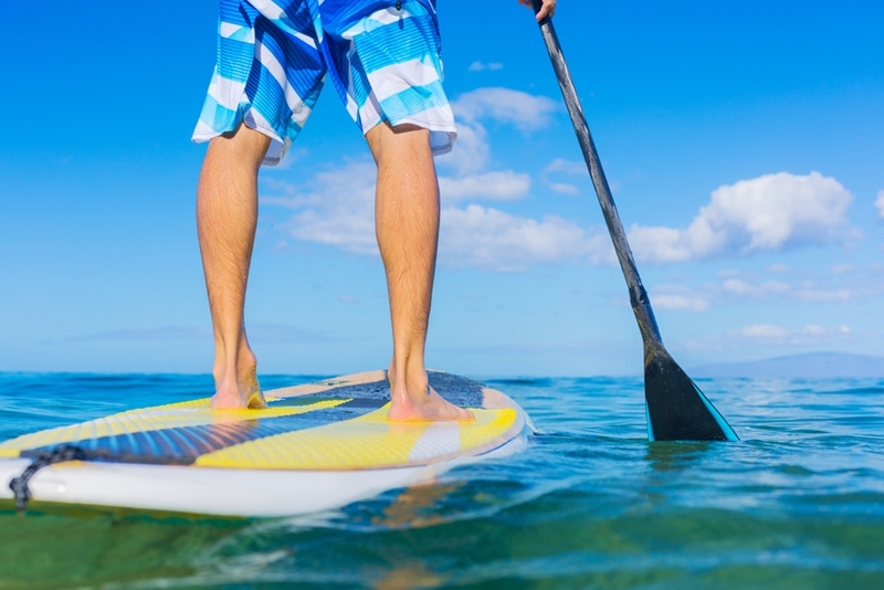 Take the kids for a paddle boarding adventure.