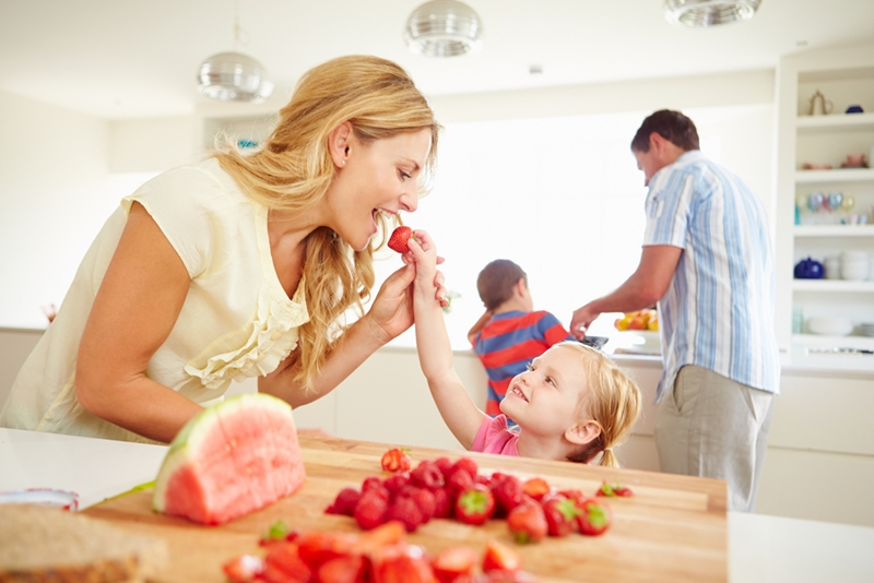 family in kitchen eating