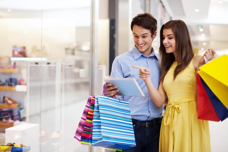 Is this couple doing their Christmas shopping while they browse investment properties online?