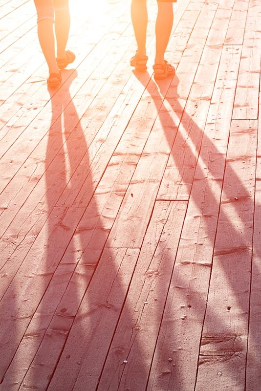 Two people walking at sunset