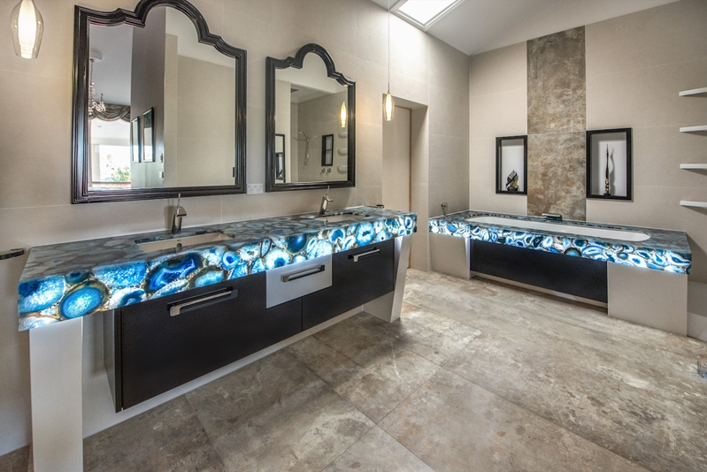 Gemstone tops become the focal point of the bathroom.