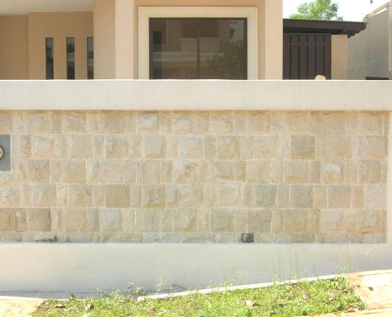 Sandstone wall tiles having been used with adhesive.
