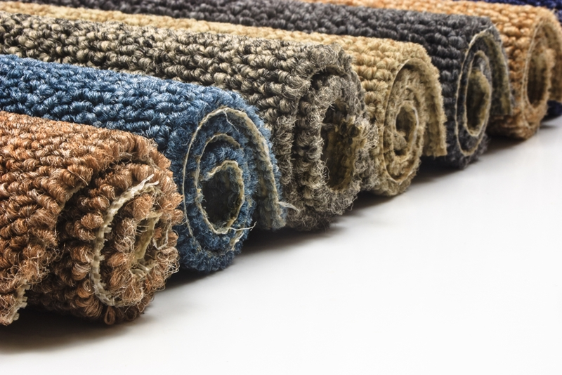 Add colour and texture to your luxury apartment with a rug.