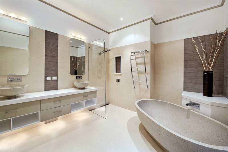 A frameless raked blade used in this award winning bathroom form Bubbles bathrooms