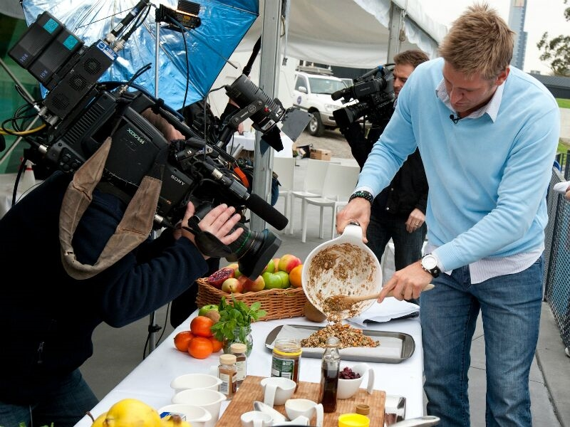 man being filmed cooking for event