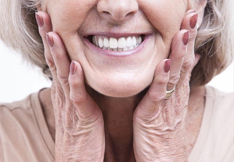 Well installed dentures, using modern techniques should be near indistinguishable from real teeth.