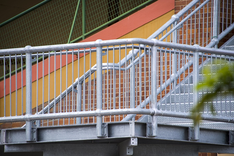 Handrails on a staircase landing.