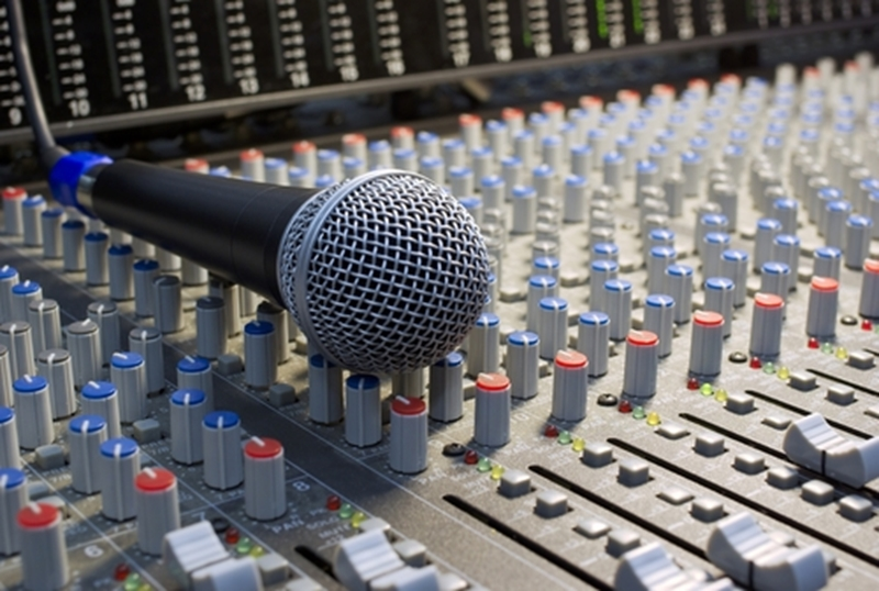 A sound board helps event management staff handle different audio channels.